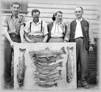 Local Wellsians holding up their catch, wpH437
